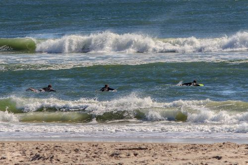 atlantic ocean,atlantic seaboard,surf,surfers,surfing,waves,beach,shore,breakers,crest,sea foam,seascape,coast