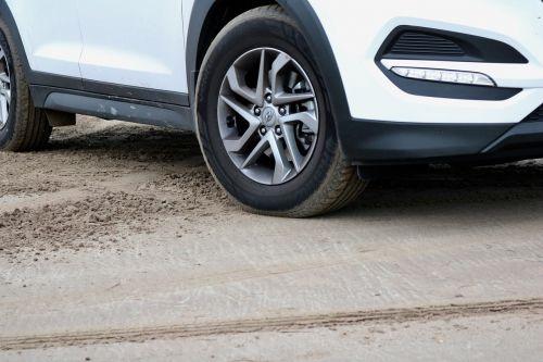 auto parked sand