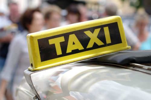 auto taxi taxi sign