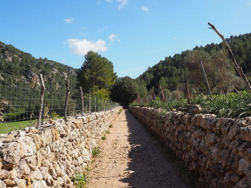away lane stone wall