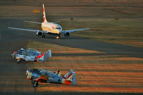 B-737 Taxying Past Parked Harvards