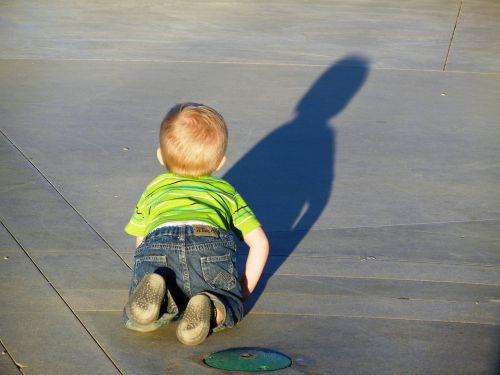 baby,crawling,caucasian,shadow,concrete
