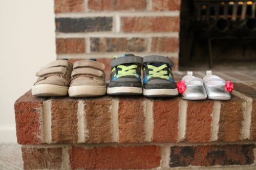 baby announcement shoes fireplace