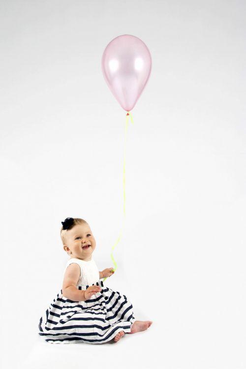 Baby Girl Holding Balloon