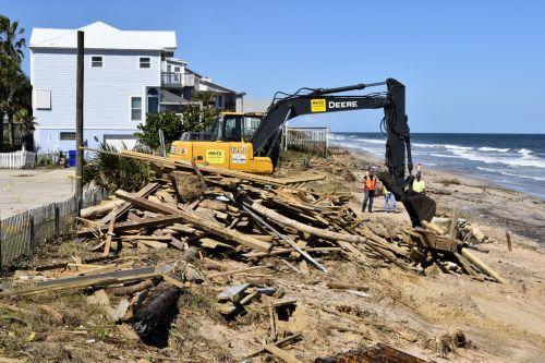 Backhoe Cleaning Up Beach Debris