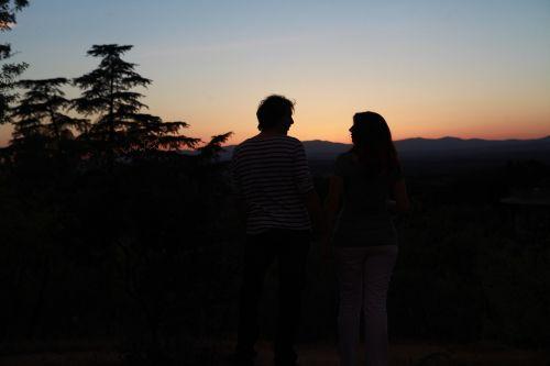 backlight sunset couple