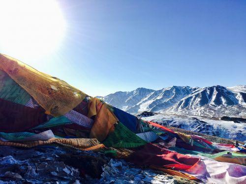 backlighting tibetan snow mountain