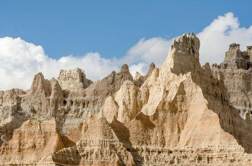badlands rock formations blue sky