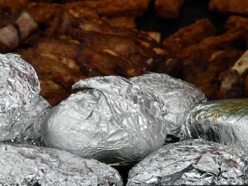 baked potatoes potato dish aluminum foil