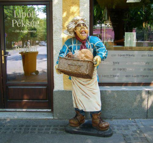 baker figure bakery pastry shop