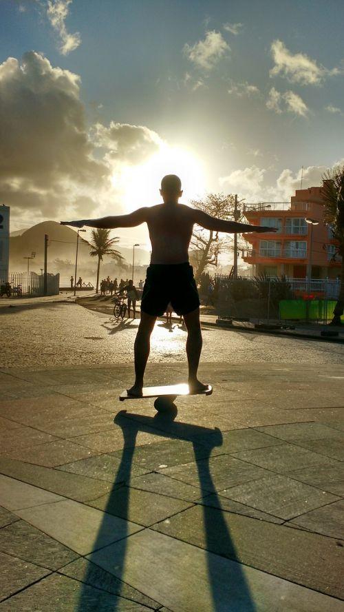 balansinė lenta,balansas,lentos balansas,saulėlydis,Rio de Žaneiras,natūralus,dangus,sol,papludimys,vakarą,prieš šviesą,Litoral,popietė,kraštovaizdis