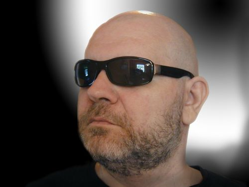 bald head man sunglasses