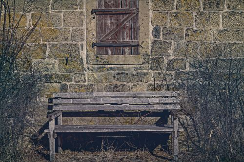 bank wooden bench wooden windows