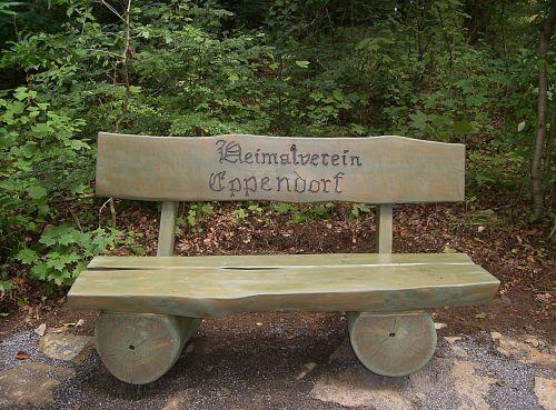 bank wooden bench inscription