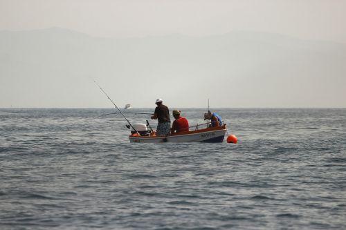 barca fishing cañas
