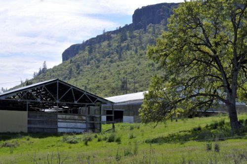 Barn At Base Of Cliff-edged Mesas