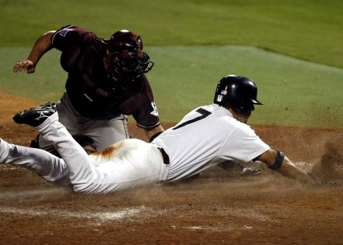 baseball catcher out at plate