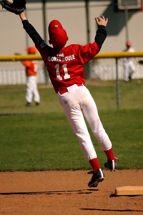baseball catching leaping