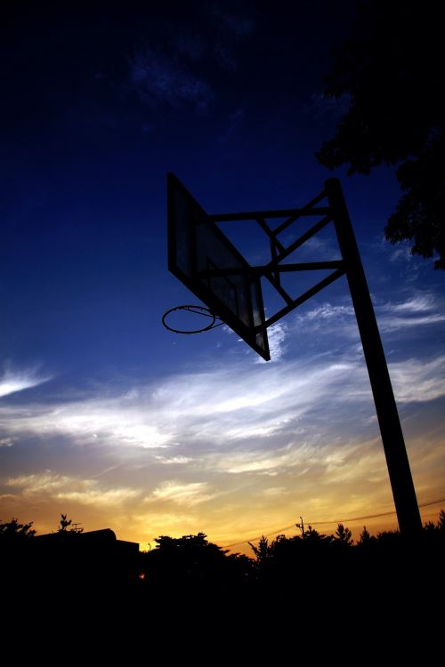 basketball hoop basketball in the evening