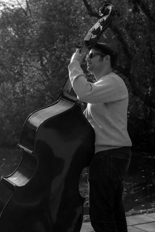 bass player musical instrument black and white