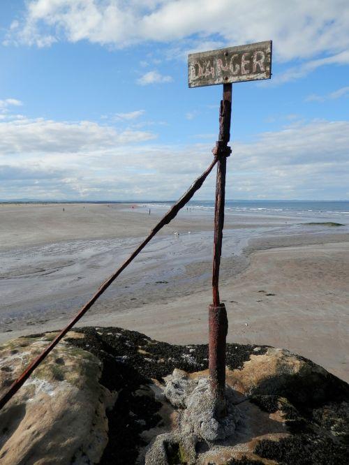 beach danger sign