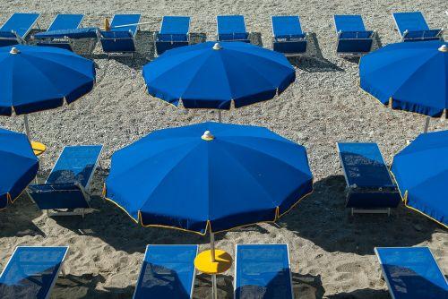 beach parasols sun loungers