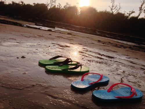 beach slippers sunset