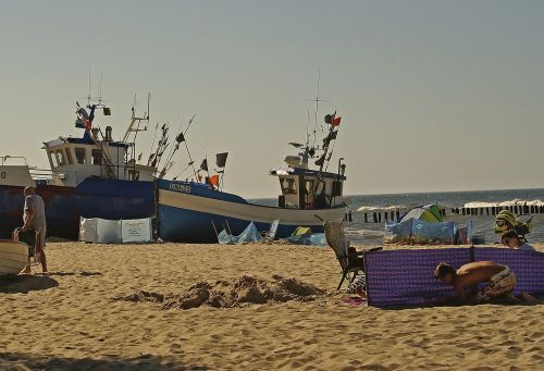 beach fishing boats boats on the sand