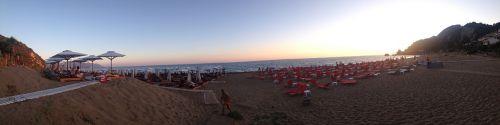 papludimys,saulėlydis,paplūdimio skėčiai,vasara,atostogos,atsipalaidavimas,laimingas,atostogos,jūra,vasaros atostogos,kelionė,vandenynas,laisvalaikis,linksmų švenčių,turizmas,mėlynas,lauke,dangus,paplūdimio linksmas,mėgautis,Krantas,atsipalaiduoti,corfu,glyfada,Graikija