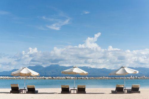 beach chairs umbrellas beach