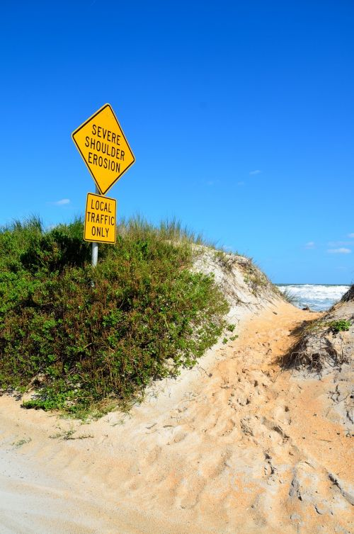 beach erosion sign beach outdoors