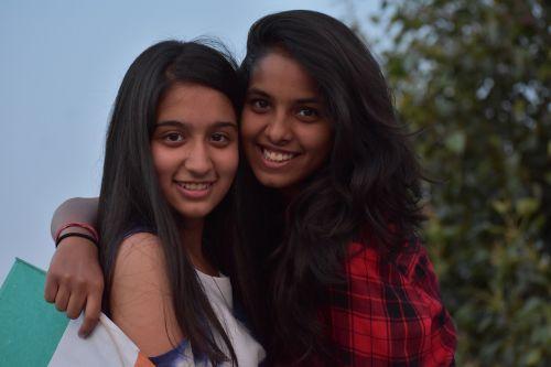 beautiful girls hugs teenage girls