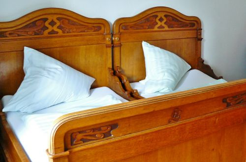 bed wooden bed bedroom