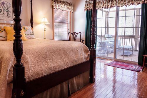 bedroom bed hardwood floor