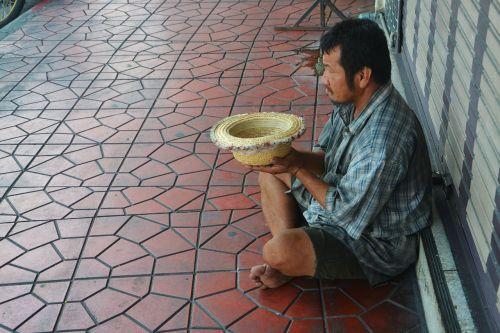 beggar begging street