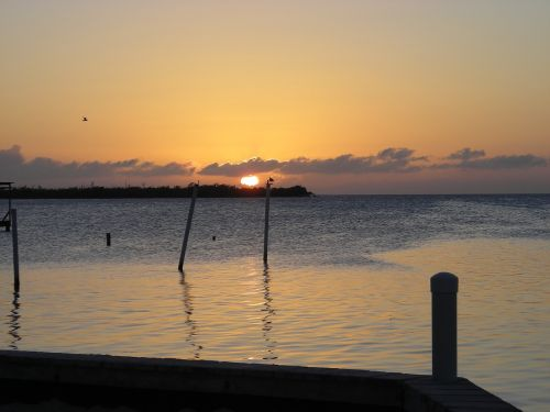 belize sunset water