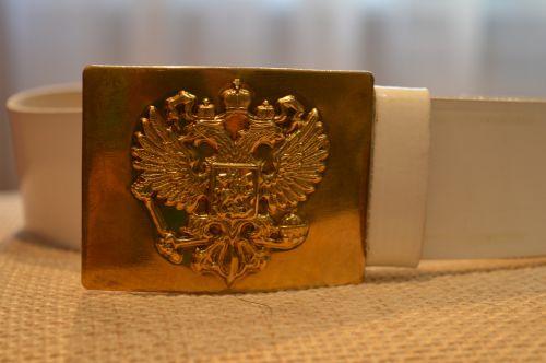 belt plaque coat on the belt