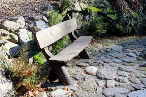 bench wooden the stones