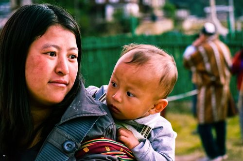 bhutanese woman with kid bhutanese kid small kid with mother