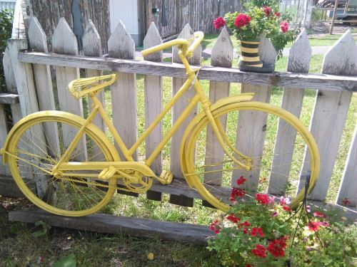 bicycle yellow yard art