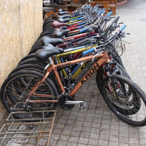 bicycles bike racks in a row