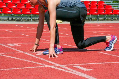 Runner On The Red Treadmill Track