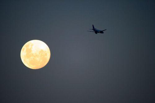 Big Jet Passing Moon