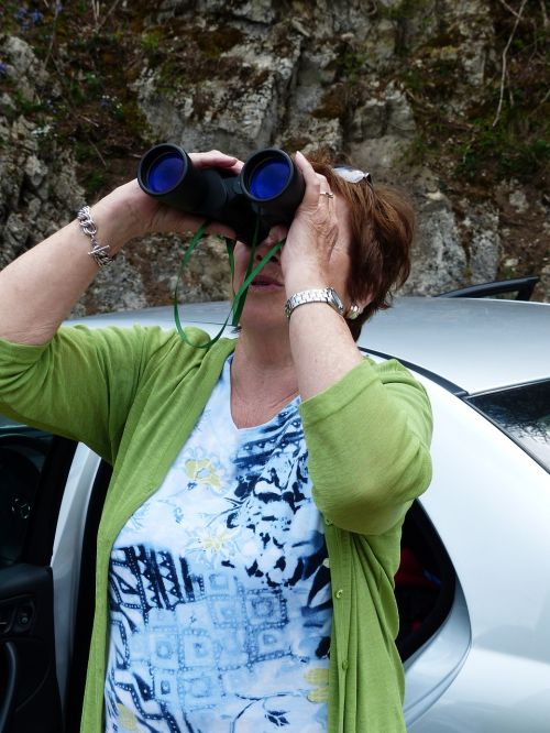 binoculars observation woman