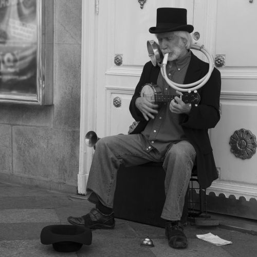 black and white one man band street