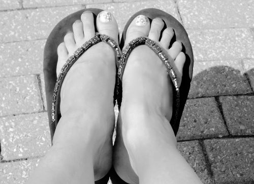 black and white feet sandals