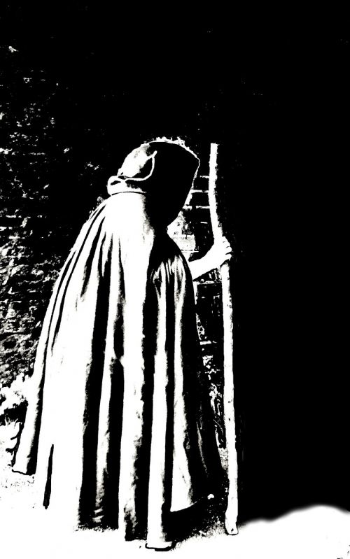 black and white cloaked figure staff