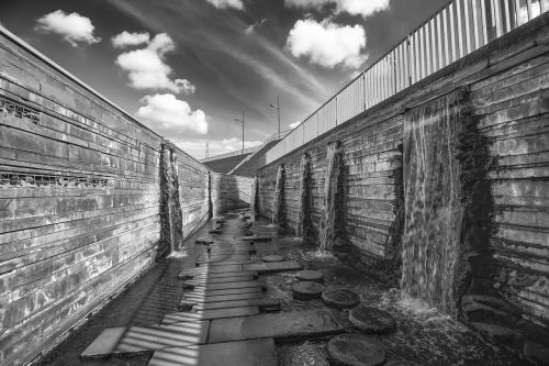 black and white photography waterfall architecture
