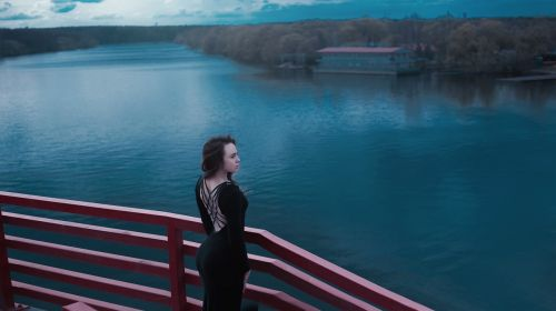 black dress with a slit on the back water
