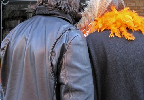 Black Leather Jacket And Orange Boa